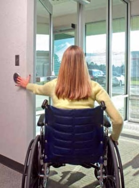Handicapped Woman Pushing on ADA-Compliant Handicap Automatic Door Operator